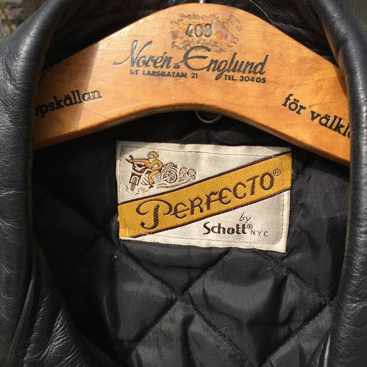 Tag inside a Schott leather jacket on a coat hanger