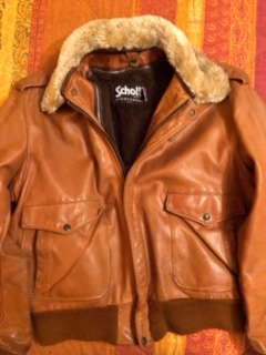 Brown leather jacket with fur collar.